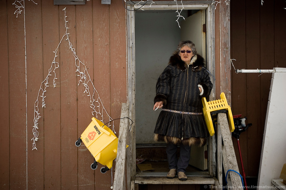 May 3, 2008 -- Kivalina, AK, U.S.A..Nelda Swan outside her home in the 400 person native village of Kivalina, Alaska. Kivalina is suing 20 oil companies for property damage related to global warming; the ocean pack ice forms later and melts earlier, leaving the town vulnerable to erosive winter storms and endangering their traditional subsistence lifestyle. (Photo by Tim Matsui)