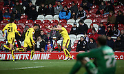 Burnley midfielder Scott Arfield celebrating with Burnley striker Andre Grey and Burnley defender Stephen Ward during the Sky Bet Championship match between Brentford and Burnley at Griffin Park, London, England on 15 January 2016. Photo by Matthew Redman.