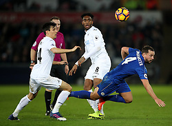Swansea City's Jack Cork (left) and Leicester City's Robert Huth battle for the ball during the Premier League match at the Liberty Stadium, Swansea.