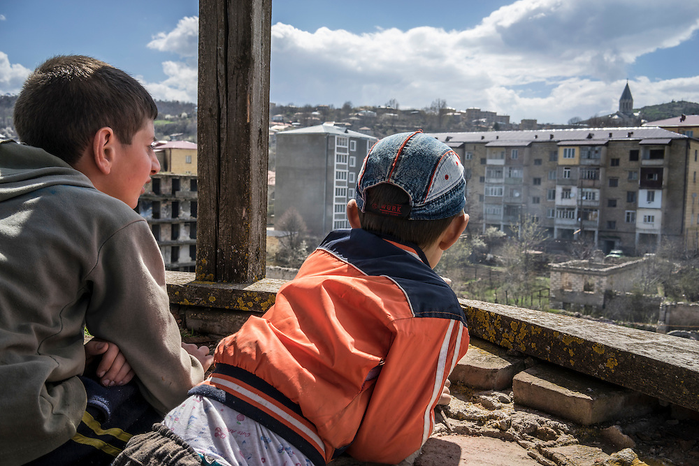 SHUSHI, NAGORNO-KARABAKH - APRIL 19: Hayk Harutyunyan (L), 7, and Vanya Hambartzumyan, 10, look from the top of one of the minarets of the Lower Mosque on April 19, 2015 in Shushi, Nagorno-Karabakh. Since signing a ceasefire in a war with Azerbaijan in 1994, Nagorno-Karabakh, officially part of Azerbaijan, has functioned as a self-declared independent republic and de facto part of Armenia, with hostilities along the line of contact between Nagorno-Karabakh and Azerbaijan occasionally flaring up and causing casualties. (Photo by Brendan Hoffman/Getty Images) *** Local Caption *** Hayk Harutyunyan;Vanya Hambartzumyan
