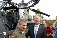 15 JUL 2002, VEITSHOECHHEIM/GERMANY:<br /> Rudolf Scharping, SPD, Bundesverteidigungsminister, vor dem Kampfhubschrauber Tiger, hier als 1:1 Modell, dem zukuenftige Mehrzweckkampfhubschrauber der Bundeswehr, Veitshoechheim<br /> IMAGE: 20020715-01-015<br /> KEYWORDS: Veitshöchheim, helicopter, Waffe, wappon, Hubschrauber