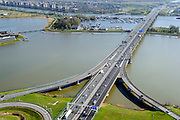 Nederland, Noord-Holland, Amsterdam, 20-04-2015; Zeeburgerbrug (Ringweg A 10) over water van het Nieuwe Diep en IJmeer (Buiten-IJ). Foto richting Diemen.<br /> Amsterdam Ring Road near IJburg, the new urban development district of Amsterdam.<br /> luchtfoto (toeslag op standard tarieven);<br /> aerial photo (additional fee required);<br /> copyright foto/photo Siebe Swart