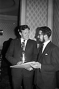 "23/03/1963<br /> 03/23/1963<br /> 23 March 1963<br /> Gaelic Sports Journalists Association Presentation off Awards at the Anchor Hotel, Dublin. Picture shows Kevin Coffey of Kerry (who accepted the football award for team mate Mick O'Connell) admiring the certificate awarded to film director Louis Marcus (right) for his direction of the Wills/Gael - Linn Gaelic Football film, ""Peil""."