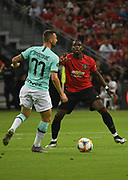 Inter Milan's Marcele Brazovic runs at Manchester United's Paul Pogba during an International Champions Cup game won by Manchester United 1-0, Saturday, July 20, 2019, in Singapore. (Kim Teo/Image of Sport)