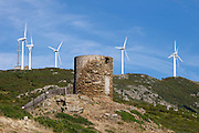 A Genovan tower in front of the windmills on top of Col de la Serra.
