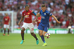 Jamie Vardy of Leicester City under pressure from Luis Antonio Valencia of Manchester United - Mandatory byline: Jason Brown/JMP - 07966386802 - 07/08/2016 - FOOTBALL - Wembley Stadium - London, England - Leicester City v Manchester United - FA Community Shield
