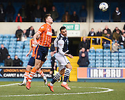 Blackpool defender Will Aimson and Millwall forward Lee Gregory challenging for the ball during the Sky Bet League 1 match between Millwall and Blackpool at The Den, London, England on 5 March 2016. Photo by David Charbit.