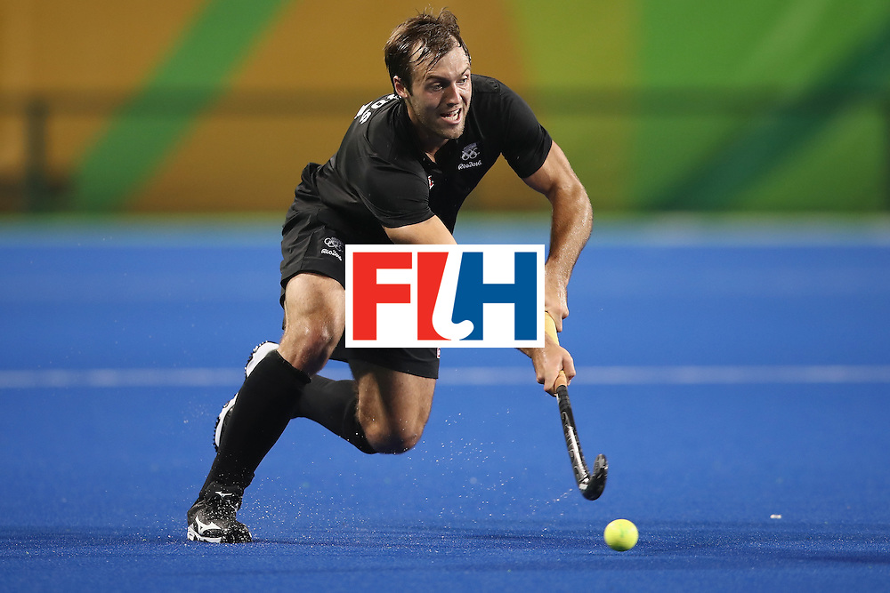 RIO DE JANEIRO, BRAZIL - AUGUST 10:  Nic Woods of New Zealand runs the ball forward during the men's pool A match between New Zealand and Brazil on Day 5 of the Rio 2016 Olympic Games at the Olympic Hockey Centre on August 10, 2016 in Rio de Janeiro, Brazil.  (Photo by Mark Kolbe/Getty Images)