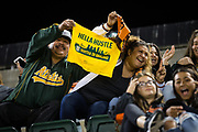 Fans watch the Oakland Athletics take on the San Francisco Giants at Oakland Coliseum in Oakland, California, on August 1, 2017. (Stan Olszewski/Special to S.F. Examiner)
