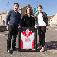 Sponsors Martin and Agnes O'Malley from Clare Car and Tractor Parts being presented with a framed jersey by Inch NS Principal Rosemary Corry
