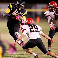 Thomas Wells   Buy at PHOTOS.DJOURNAL.COM<br /> Itawamba quarterback Austin King tries to get through Corinth's Treven Knight Friday night.