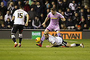 Reading FC defender Chris Gunter wins a hard challenge with Derby County forward Johnny Russell during the Sky Bet Championship match between Derby County and Reading at the iPro Stadium, Derby, England on 12 January 2016. Photo by Aaron Lupton.