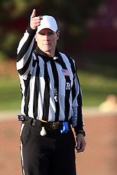 15 October 2011: 1st down signals referee Kerry Ripley after a turnover during an NCAA football game between the University of South Dakota Coyotes and the Illinois State Redbirds (ISU) at Hancock Stadium in Normal Illinois.