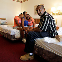 SHREVEPORT, LA - September 2, 2005:  Ralph Finlay and his family , Sedeana Hausey (girlfriend with whom he lives and raises her daughters), 40, her daughter's Chelsa Mims, 11, (on Sedeana's right), and Morissa Brooks, 13 (on Sedeana's left). Photographed inside their Super 8 motel room in Shreveport, LA on Sept 2, 2005 where the family evacuated to after fleeing New Orleans. (Photo by Todd Bigelow/Aurora)
