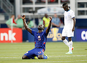 Haiti defender Kevin LeFrance (13) celebrates his team's 1-0 win as Honduras forward Rubillo Castillo (8) walks past at the end of a CONCACAF Gold Cup soccer match, Monday, July. 13, 2015, in Kansas City, Kan. (AP Photo/Colin E. Braley)