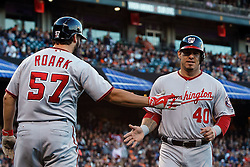 SAN FRANCISCO, CA - JULY 28: Wilson Ramos #40 of the Washington Nationals is congratulated by Tanner Roark #57 after scoring a run against the San Francisco Giants during the second inning at AT&T Park on July 28, 2016 in San Francisco, California.  (Photo by Jason O. Watson/Getty Images) *** Local Caption *** Wilson Ramos; Tanner Roark