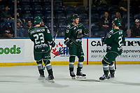 KELOWNA, CANADA - JANUARY 9:  Jake Christiansen #23; Bryce Kindopp #19 and Wyatte Wylie #29 of the Everett Silvertips celebrate a goal against the Kelowna Rockets on January 9, 2019 at Prospera Place in Kelowna, British Columbia, Canada.  (Photo by Marissa Baecker/Shoot the Breeze)
