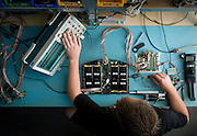 An engineer tests components at Rex Bionics.