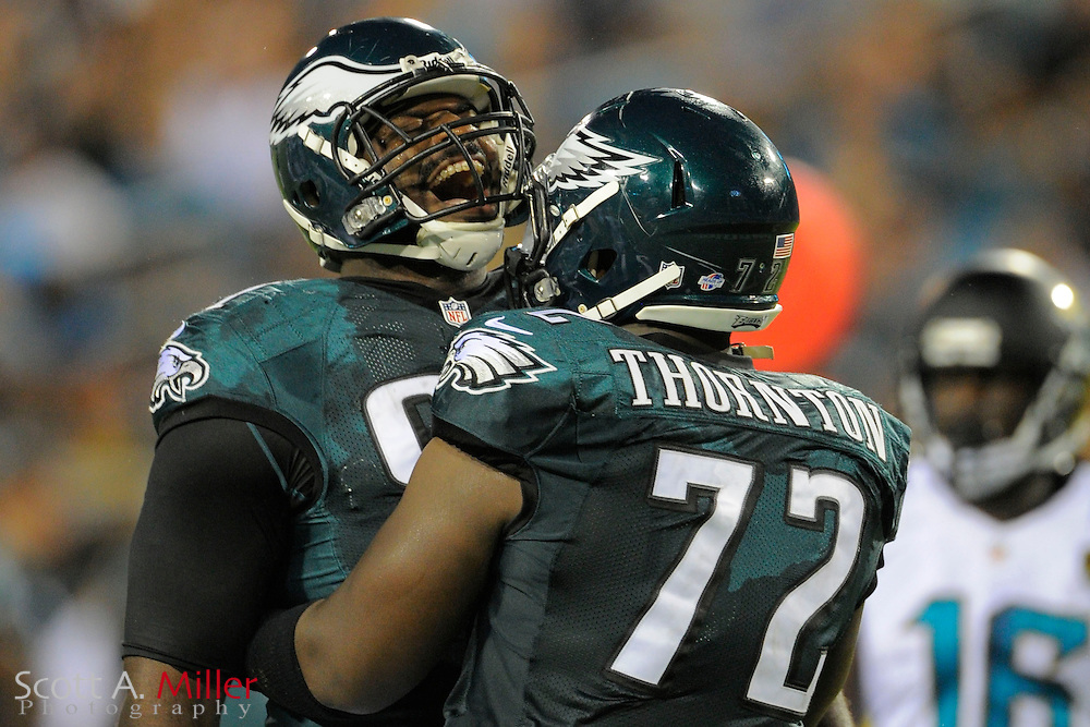 Philadelphia Eagles tackle Cedric Thornton (72) and defensive tackle Fletcher Cox (91) celebrate a defensive play during a preseason NFL game against the Jacksonville Jaguars at EverBank Field on Aug. 24, 2013 in Jacksonville, Florida. The Eagles won 31-24.<br /> <br /> &copy;2013 Scott A. Miller