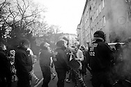 Germany, Frankfurt am Main :  Activists  protesters dressed as  clown walk  past riot policemen during a demonstration organized by the Blockupy movement to protest against the policies of the European Central Bank (ECB) on March 18, 2015. The Ecb inaugurated today its new headquarter.<br /> <br /> .