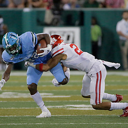Sep 19, 2019; New Orleans, LA, USA; Tulane Green Wave wide receiver Jaetavian Toles (82) is tackled by Houston Cougars safety Gleson Sprewell (21) during the first half at Yulman Stadium. Mandatory Credit: Derick E. Hingle-USA TODAY Sports