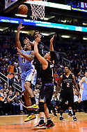 Jan 28, 2017; Phoenix, AZ, USA; Denver Nuggets guard Gary Harris (14) drives the ball in front of Phoenix Suns forward Marquese Chriss (0) and guard Devin Booker (1) in the first half of the NBA game at Talking Stick Resort Arena. Mandatory Credit: Jennifer Stewart-USA TODAY Sports