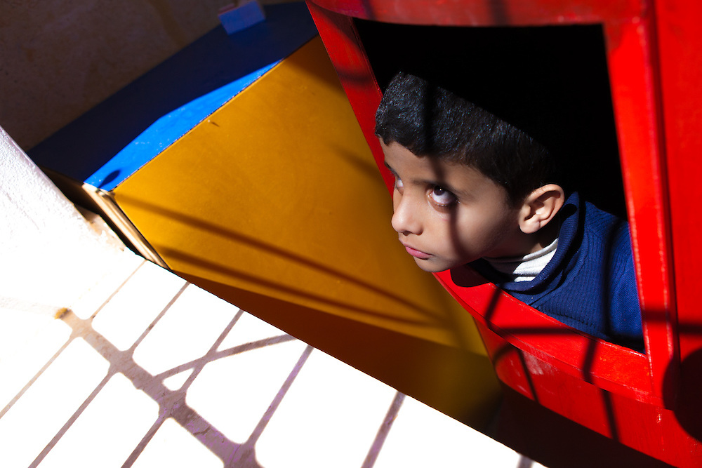 Mourhaf (6) was born both deaf and blind, although he can distinguish between pitch blackness and very bright lights. He likes to stare at the sun. During weekdays, he lives at the Holy Land Institute for the Deaf in Salt, Jordan.