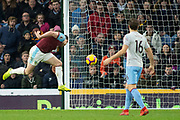 Burnley forward Ashley Barnes (10) heads the ball towards goal during the Premier League match between Burnley and West Ham United at Turf Moor, Burnley, England on 30 December 2018.