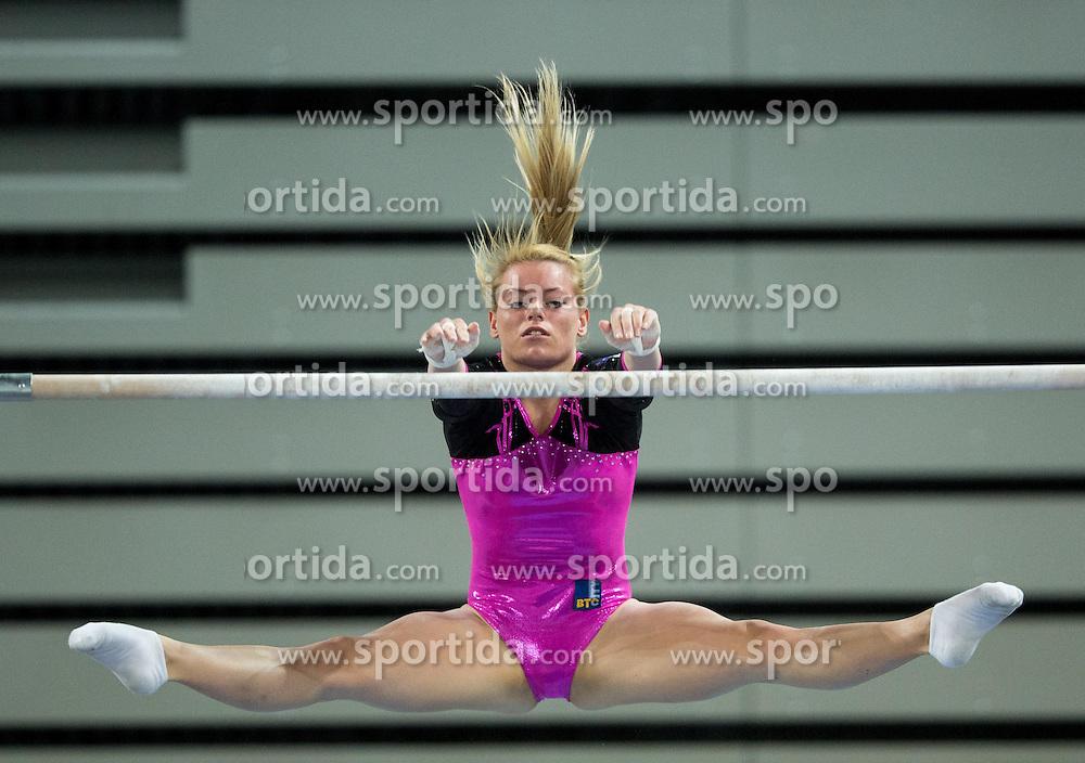 Teja Belak of Slovenia competes in the Uneven bars during Qualifications of Artistic Gymnastics World Challenge Cup Ljubljana, on April 3, 2015 in Arena Stozice, Ljubljana, Slovenia. Photo by Vid Ponikvar / Sportida
