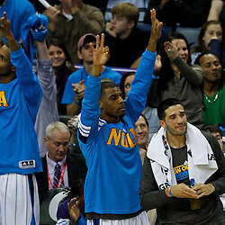 December 28, 2011; New Orleans, LA, USA; New Orleans Hornets players react during the fourth quarter of a game against the Boston Celtics at the New Orleans Arena. The Hornets defeated the Celtics 97-78.  Mandatory Credit: Derick E. Hingle-US PRESSWIRE