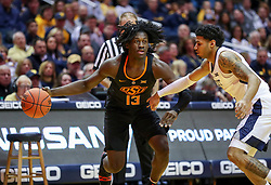 Jan 12, 2019; Morgantown, WV, USA; Oklahoma State Cowboys guard Isaac Likekele (13) dribbles during the first half against the West Virginia Mountaineers at WVU Coliseum. Mandatory Credit: Ben Queen-USA TODAY Sports