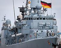 DEU, Deutschland, Wilhelmshaven, 24. Maerz 2016: Die  Fregatte F213 &quot;Augsburg&quot; der Bundesmarine wird im Marinehafen von Wilhelmshaven  an ihren Liegeplatz geschleppt. Das Schiff kehrt von einer mehrmonatigen Reise aus dem Persischen Golf zurueck, wo es den franzoesischen Flugzeugtraeger &quot;Charles de Gaulle&quot; bei der Operation &quot;Counter Daesh MAR&quot; im Kampf gegen den so genannten IS in Syrien und im Irak unterstuetzt hat. | DEU, Germany, Wilhelmshaven, March 24, 2016: The frigate F213 &quot;Augsburg&quot; of the German Navy is pictured at the Navy port of Wilhelmshaven. The vessel returns from a mission in the Persian Gulf where it supported the French aircraft carrier &quot;Charles de Gaulle&quot; in the Operation &quot;Counter Daesh MAR&quot; against the so called IS in Syria and Iraq |<br /> <br /> [ CREDIT: www.fockestrangmann.de - MWSt./VAT/TVA  7 % - Focke Strangmann Fotos - Rossbachstr. 46 - 28201 B r e m e n - Germany - Tel.  +49.163.2513863  - ich@fockestrangmann.de - Bank: S p a r k a s s e B r e m e n  BLZ: 29150101 Konto: 10886646 IBAN: DE05 2905 0101 0010 8866 46 00 BIC: SBREDE22 Stnr. 602730314, FA Bremen, VAT DE225275020 - ] <br /> <br /> [#0,26,121#]