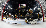 LAS VEGAS, NV - MARCH 18:  Marc-Andre Fleury #29 of the Vegas Golden Knights defend the net after Fleury lost his stick in the second period of their game against the Calgary Flames during the game at T-Mobile Arena on March 18, 2018 in Las Vegas, Nevada.  (Photo by Jeff Bottari/NHLI via Getty Images)