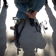 November 14, 2012 - Kabul, Afghanistan: A Afghan National Police (ANP) cadet kneels behind a dismantled AK-47 during weapon handling training in the yard of the Afghan Nacional Police Academy...ANP Academy trains 1250 cadets at the time during a period of four years. Every year, five hundred new recruits are selected, out of more than nine thousand of candidates, to join the academy and other five hundred graduate. Fifteen per cent of the recruits are women. (Paulo Nunes dos Santos)