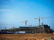 """13 FEBRUARY 2019 - SIHANOUKVILLE, CAMBODIA: There are about 80 Chinese casinos and resort hotels open in Sihanoukville and dozens more under construction. The casinos are changing the city, once a sleepy port on Southeast Asia's """"backpacker trail"""" into a booming city. The change is coming with a cost though. Many Cambodian residents of Sihanoukville  have lost their homes to make way for the casinos and the jobs are going to Chinese workers, brought in to build casinos and work in the casinos.      PHOTO BY JACK KURTZ"""