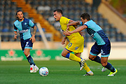 Cody McDonald (10) of AFC Wimbledon battles with Adam El-Abd (6) of Wycombe Wanderers during the Pre-Season Friendly match between Wycombe Wanderers and AFC Wimbledon at Adams Park, High Wycombe, England on 25 July 2017. Photo by Graham Hunt.