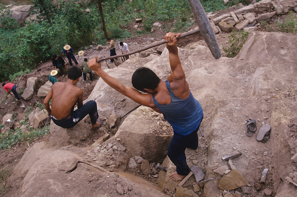 China, Hubei Province, Workmen build new road bed by hand in small Yangtze River village of Lian Feng