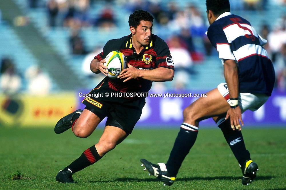 Daryl Gibson stepping, Canterbury RFU v Auckland, Air NZ Cup NPC Rugby Union. 1998. Photo: Andrew Cornaga/PHOTOSPORT