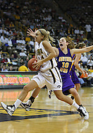 December 22 2010: Iowa guard Jaime Printy (24) drives past Northern Iowa guard Jacqui Kalin (10) during the second half of an NCAA college basketball game at Carver-Hawkeye Arena in Iowa City, Iowa on December 22, 2010. Iowa defeated Northern Iowa 75-64.