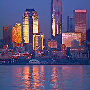 Seattle Washington skyline at sunset view from Alki Beach in West Seattle across Elliott Bay downtown business core<br />