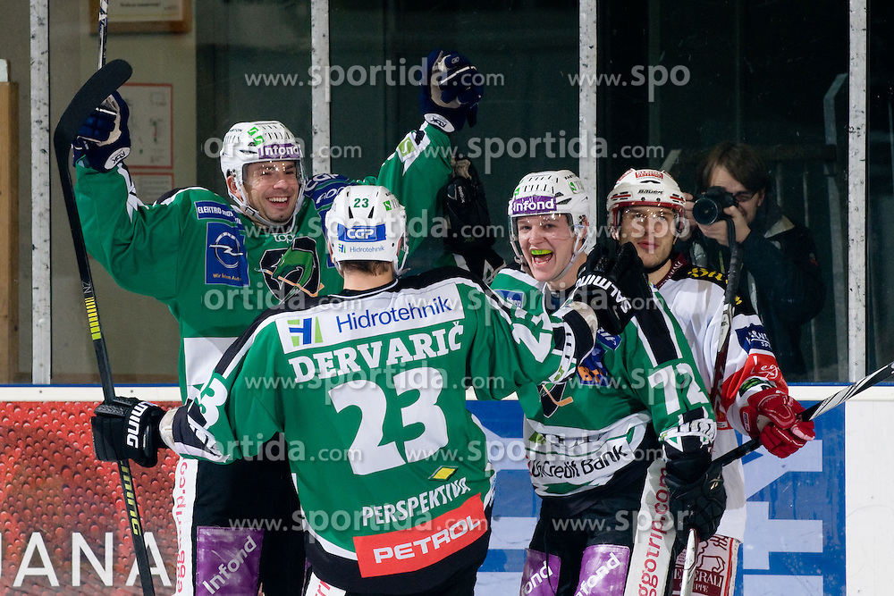 Team HDD Tilia Olimpija celebrate during ice-hockey match between HDD Tilia Olimpija and EC KAC in 32nd Round of EBEL league, on December 30, 2010 at Hala Tivoli, Ljubljana, Slovenia. (Photo By Matic Klansek Velej / Sportida.com)