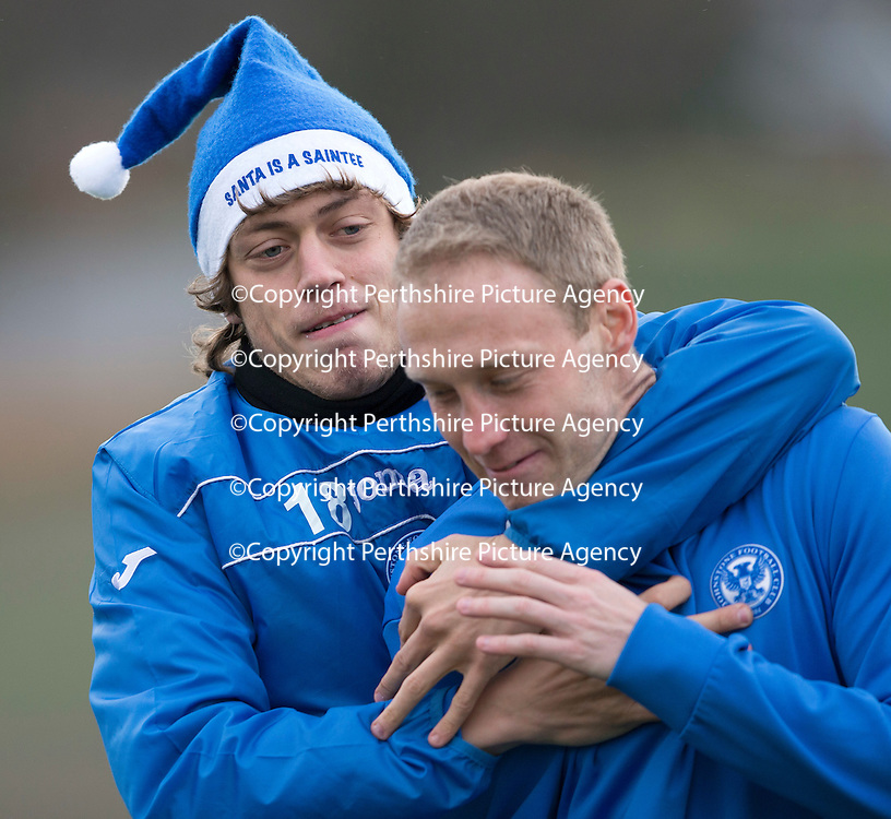 St Johnstone Training....20.12.13<br /> Murray Davidson clowning around with Steven Anderson in training today ahead of tomorrow's game at Hibs.<br /> Picture by Graeme Hart.<br /> Copyright Perthshire Picture Agency<br /> Tel: 01738 623350  Mobile: 07990 594431