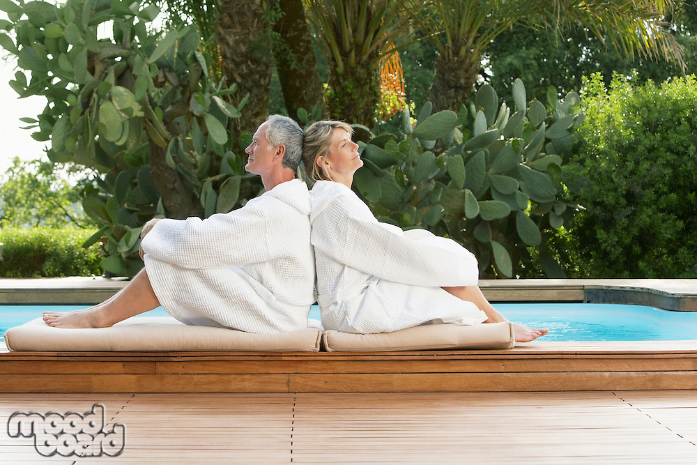 Senior Couple Relaxing by Poolside