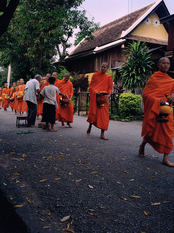 Monks with receiving food from morning offerings.