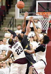 Missouri's Russell Woods (25) attempts a layup while be defended by Texas A&M's Danuel House (23) and Tonny Trocha-Morelos (10) during the second half of an NCAA college basketball game, Saturday, Jan. 23, 2016, in College Station, Texas.  Texas A&M won 66-53.  (AP Photo/Sam Craft)