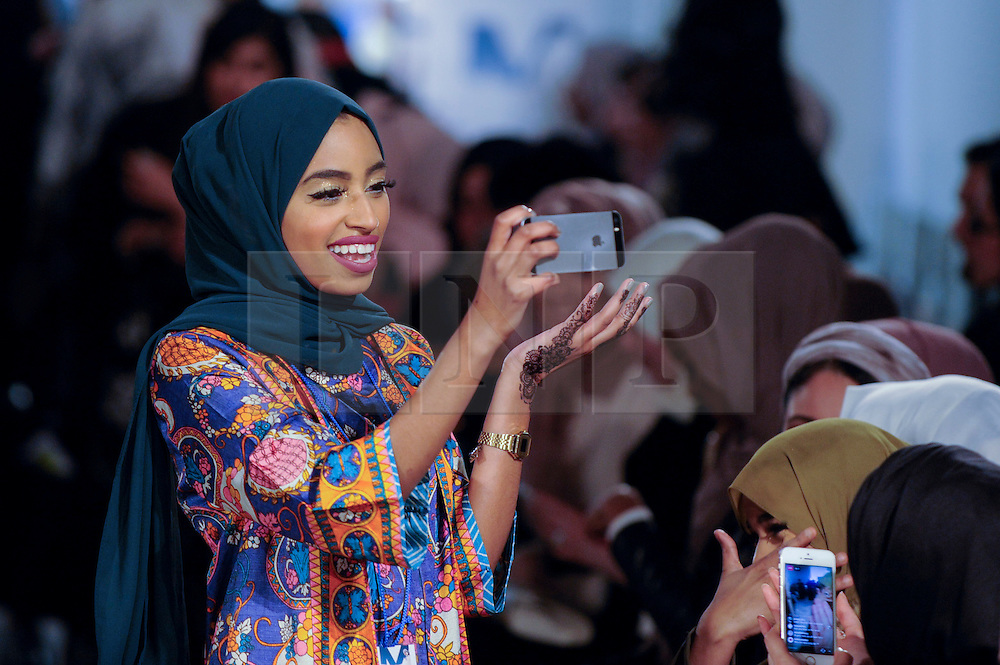© Licensed to London News Pictures. 18/02/2017. London, UK.   A woman in the audience awaits the first catwalk of the day at the UK's first London Modest Fashion Week taking place this weekend at the Saatchi Gallery.  The two day event sees 40 brands from across the world come together to showcase their collections for Muslim and other religious women. Photo credit : Stephen Chung/LNP