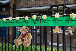 London, UK. 14 June, 2019. Tributes to those who lost their lives in the Grenfell Tower fire close to the tower on the second anniversary of the tragedy on 14th June 2017 which claimed the lives of 72 people and injured over 70 more.