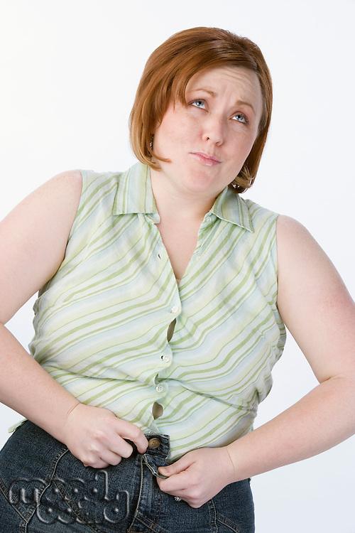 Studio portrait of overweight woman