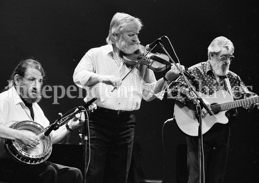 The Dubliners in Concert in the Olympia Theatre, Barney McKenna, John Sheahan and Ronnie Drew, Dublin, circa August 1992 (Part of the Independent Newspapers Ireland/NLI Collection).