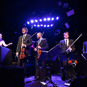 January 8, 2012 - Manhattan, NY : Andrew W.K. (piano and vocals), far left, thanks the The Calder Quartet after they performed at Le Poisson Rouge in Manhattan on Sunday evening. The quartet is comprised of,  wearing suits from left, Benjamin Jacobson (violin), Andrew Bulbrook (violin), Jonathan Moerschel (viola), and Eric Byers (cello).   CREDIT: Karsten Moran for The New York Times